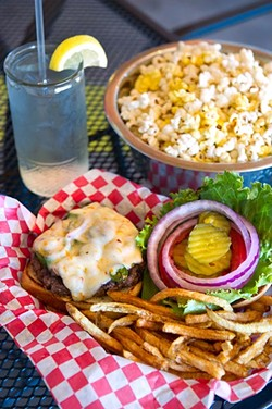 First came the popcorn in a cute dog bowl, and then came the El Toro burger made with fresh grilled jalapeños, onions, habanero jack cheese and homemade ghost pepper mayonnaise with crispy shoestring French fries at Stray Dog Cafe. (Shannon Cornman)