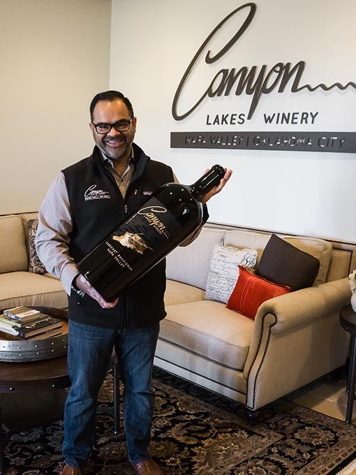 Piyush Patel with a 12L bottle of our 2013 Cabernet Sauvignonof, at  Canyon Lakes wine.  Provided