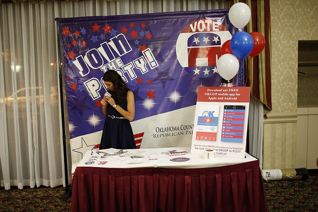 Sarahi Wilson, with OKGOP, gets ready during a Republican Party election night watch party at Tower Hotel in Oklahoma City, Tuesday, Nov. 4, 2014.  Photo by Garett Fisbeck - GARETT FISBECK