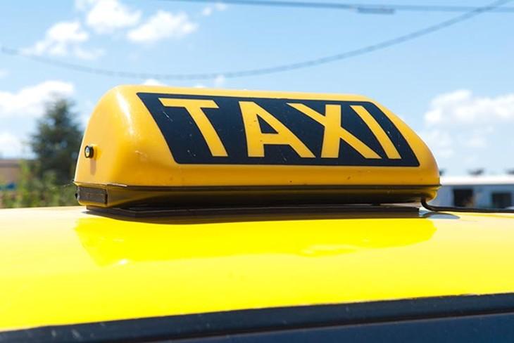 TAXI light atop a Thunder Cab. - MARK HANCOCK