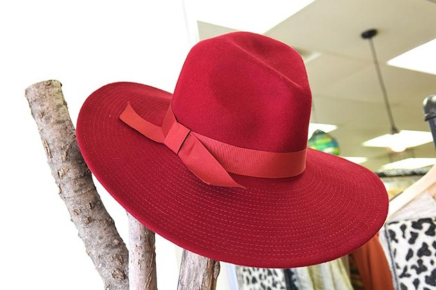 A wide brimmed red hat, at Milo & Lily Boutique, on North May Avenue in OKC, 11-11-15. - MARK HANCOCK