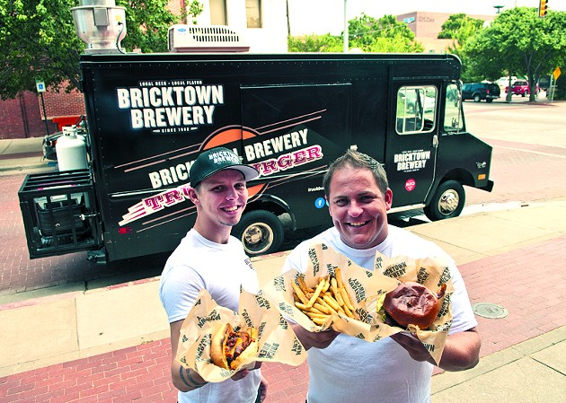 Left, Ryan Reynolds and Blake Lippert with hotdogs, fries and Burgers, surved by the Truckburger truck, parked behind them in Bricktown. (Mark Hancock)