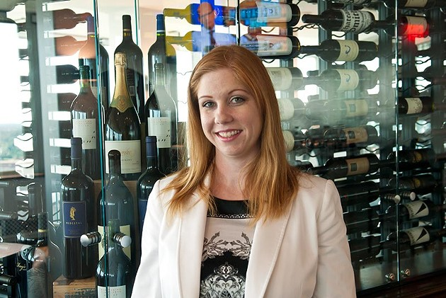 The George's female sommelier Mindie Magers with its extensive wine collection. (Mark Hancock)