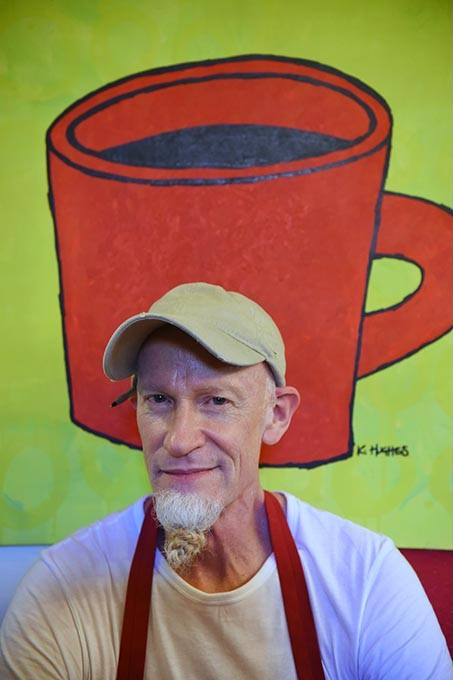 The Red Cup's founder and owner, Kurt Orth, in front of an iconic Red Cup painting at the 20 year old establishment.  mh