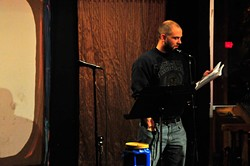 OKLAHOMA CITY, OK - NOVEMBER 12, 2014: Benjamin Cease reads a poem to members of Red Dirt Poetry at Sauced in Oklahoma City Wednesday November 12, 2014. - CREDIT: Nick Oxford for The Oklahoma Gazette - NICK OXFORD