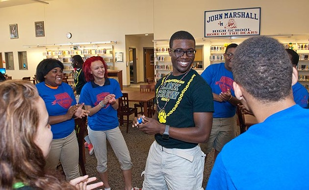 Lenard Leviston III, center, with surrounded by freshman and other Link Leaders, in the library at John Marshall High School.  mh