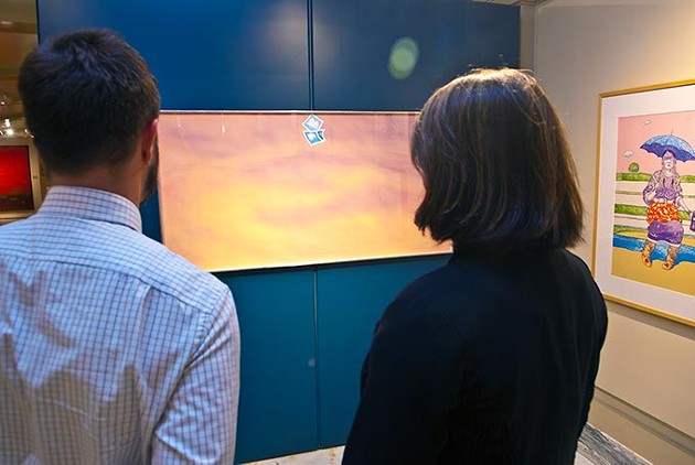 Joel Gavin and Amber Sharples of the State Arts Council, look up at an untitled work by artist Joe Goode, hanging in the Oklahoma State Art Collection gallery.  This photo goes with photo 01, shot in front of them.  mh