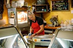 Bill Kamp works in his meat market in Oklahoma City, Friday, July 24, 2015. - GARETT FISBECK
