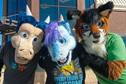 Oklacon furry convention participants from left, Kobalt Silverstar is Mark Franks, Misora is Rachel Swyear, and Zaf is Zachary McWilliams, on a street corner recently in Moore Oklahoma.  mh