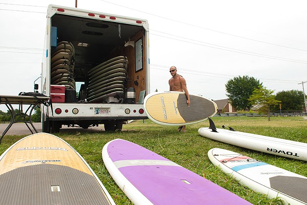 Flat Tide Mobile Surf rentals', Eric Pappas, with his truck and rental boards parked at the North Canadian River section conecting Lake Overholser with Stinchcomb Wildlife Refuse. - MARK HANCOCK