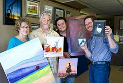 At Denton Framing, owners prepare for their Mix of Six Art Show to be held at Fine Arts Museum in Edmond. From left Mary Lou Moad, John Moad, Mikah Moad, Mark Moad.Photo/Shannon Cornman