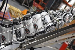 Spare Rib Pale Ale containers just before filling, on the assembly line at Coop Ale Works, Oklahoma City, 2-10-16. - MARK HANCOCK