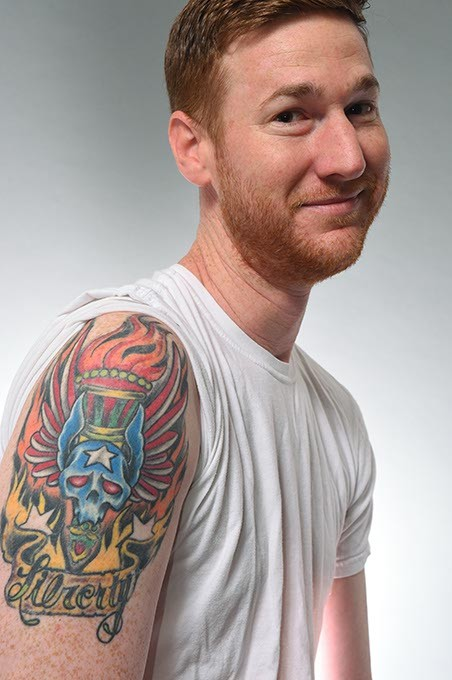 "Comedian Spencer Hicks with his misspelled (then ""fixed"") tattoo. (Mark Hancock)"