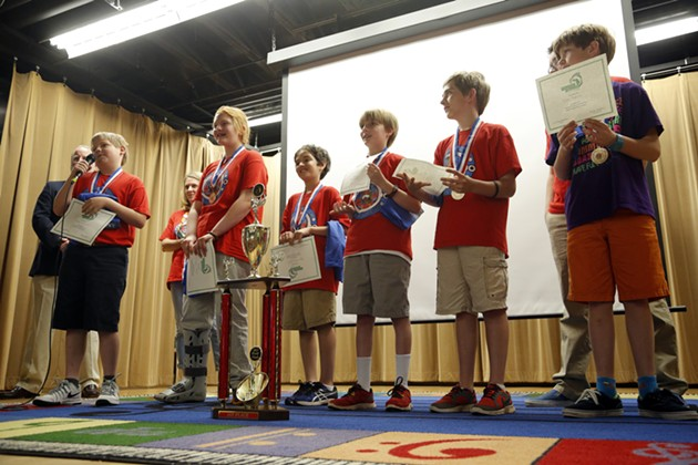 Cleveland Elementary's Odyssey of Mind team, Bobby Cochrane, Jordan Keast, Ryan McLaughlin, Drew Marshall, Noah Reid, and Ian Oswald receive their trophy for placing first in the world finals, Friday, May 29, 2015.  The team shared stories from their trip. - GARETT FISBECK