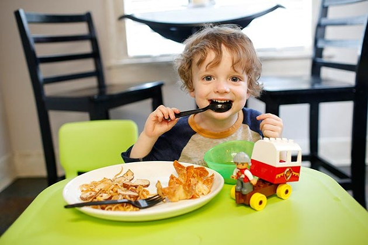 Jackson Watts eats tofu pad thai and miso soup in his home. (Garett Fisbeck)