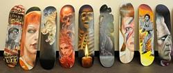 Painted skateboards at Mind Bender Tattoo Shop in Oklahoma City, Wednesday, July 22, 2015. - GARETT FISBECK