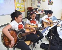 Mariachi students playing a song in Christiaan Osborn's class at Filmore Elementary School in South Oklahoma City, 1-15-16. - MARK HANCOCK