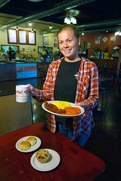 Liz Richards brings breakfast and coffee to diners at Shartel Cafe. (Mark Hancock)