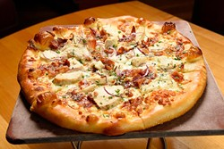 Al Frey Do Chicken pizza at Upper Crust Pizza, Friday, March 18, 2016. - GARETT FISBECK