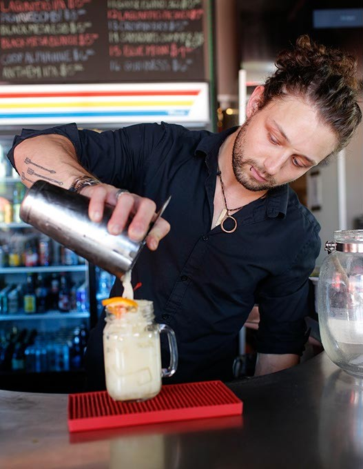 Jesse Wales makes a Kahiki Kai at The Pump in Oklahoma City, Wednesday, June 24, 2015. - GARETT FISBECK