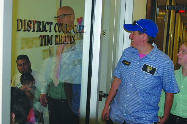 A couple walks into the Oklahoma County clerk's office on Monday hours after same-sex marriage became legal in Oklahoma. - BEN FELDER