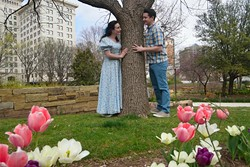 """Ardin Walker as """"Luisa"""" and Nate Stukey as """"Matt"""", play around a tree in this promotional shot for the Lyric Theatre production of """"The Fantastics"""", photographed at the Myriad Botanical Gardens, 3-11-16. - MARK HANCOCK / FOR THE GAZETTE"""