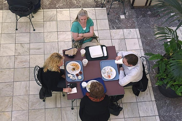 People having lunch down in the food court on the lower leval of Robinson Renaissance in Downtown OKC.  mh
