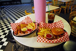 Chicken fingers and fries, left, with a bacon cheesburger and fries, at So Fine. (Mark Hancock)