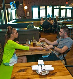 Carlie Cook and Jeffery Chander are caught sharing the tasty food at Whiskey Cakes.  mh