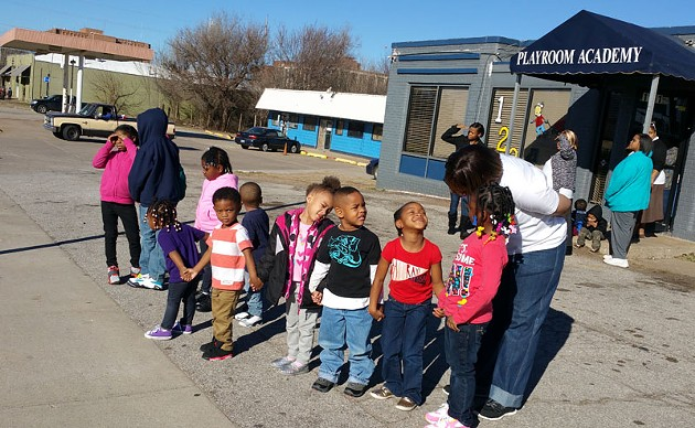 Angela Billings brings a class from Playground Academy daycare out to 23rd Street to watch a march on Martin Luther King Jr. Day. - BEN FELDER