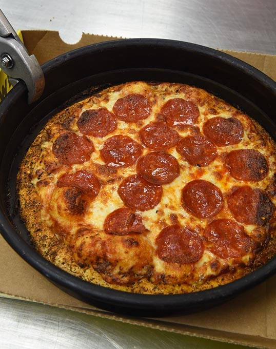 Get a personal pan baked pizza to go at Hungry Howies in Del City, of course they keep the pan, 9-23-15. - MARK HANCOCK
