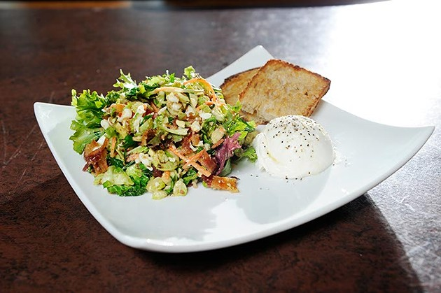 Warm kale and brussels sprouts salad at Cafe 501 in Oklahoma City, Monday, Jan. 26, 2015. - GARETT FISBECK