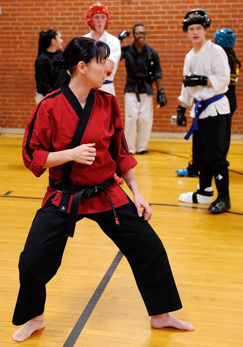 Jennifer Allman does a demonstration for her Martial Arts students at Harding Fine Arts Academy in Oklahoma City, Wednesday, Jan. 21, 2015. - GARETT FISBECK