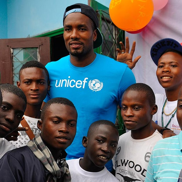"""Hi, here's info from Jordi, Serge's agent (or whatever the title is). - """"all of them are in Brazzaville. The 2 with the Unicef shirt are at the orphanages. Same as the one with the kids and the Welcome sign. - The one where Serge is shooting is at the new Avenir du Rail court. - The other is from the Place de Gaulle court, which will hopefully be rebuild soon. - Please credit them all as SERGE IBAKA FOUNDATION """""""
