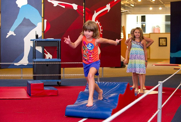 Riley Ann Taylor runs the Obstacle Course at Science Museum Oklahoma while her sister Alexandra anxiously waits her turn. - SHANNON CORNMAN