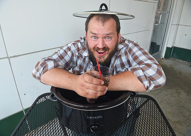comedian Zach Smith, with his Crock-Pot and cocktail, is ready for Vegas, photographed at The Pump Bar, 8-26-15.  mh