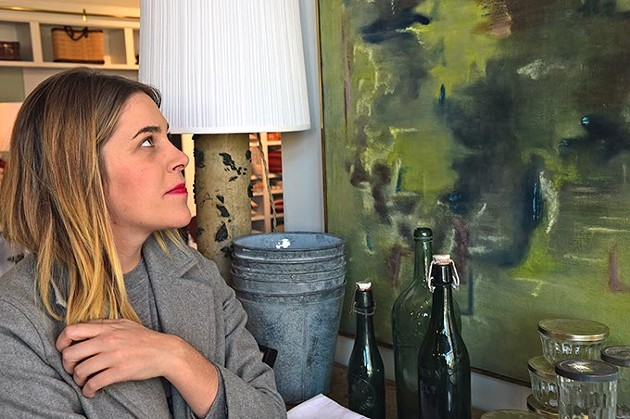 Sara Kate Huff, owner of Sara Kate Studios in Automobile Alley, with artwork and other home decor items at the new shop.  mh
