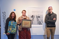 From left, Kerri Shadid, organizer Laura Reese and Ryan Harris, pose with three of their submissions for Passwords, an exhibition by six artists working with text, at IAO on Film Row in OKC, 11-17-15. - MARK HANCOCK