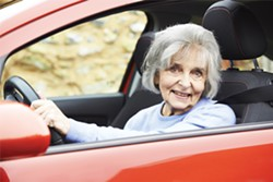 Portrait Of Smiling Senior Woman Driving Car - BIGSTOCK
