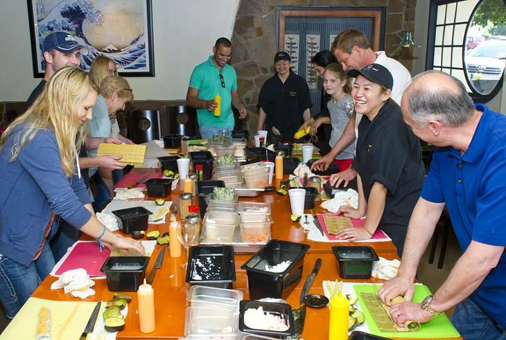 Students having fun making 6 different kinds of sushi at Sushi Neko's sushi class.Photo/Shannon Cornman - SHANNON CORNMAN