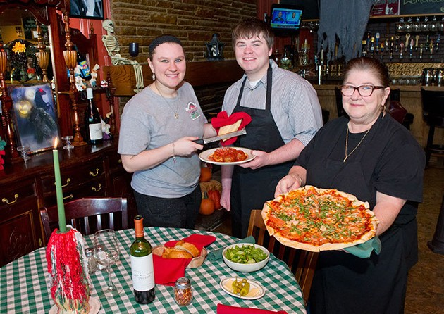 Ashton, Tony and Vicki Muhs hold wood-fired oven pizza and spaghetti with meatballs in one of Gabriella's dining rooms.