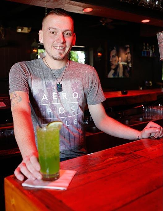 Randy Lewis with a Liquid Marijuana at Tramp's in Oklahoma CIty, Wednesday, June 24, 2015. - GARETT FISBECK