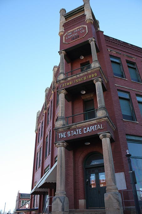 The State Capital Publishing Company Building sits at the intersection of Harrison Avenue and Second Street in Guthrie.  Photo by Laura Eastes - LAURA EASTES