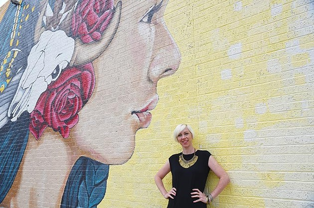 Muralist and art director Erin Cooper with work she co-created on the north wall of what was Bruno's Furniture, now K&N Interior Consignment, on N. Western Avenue, 9-30-15. - MARK HANCOCK