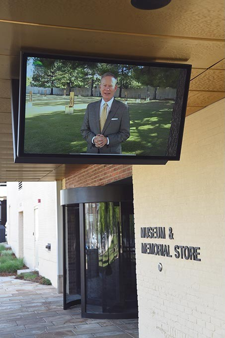 A video with Mayor Mick Cornett welcomes visitors near the entrance of the Oklahoma City National Memorial & Museum. (Mark Hancock)
