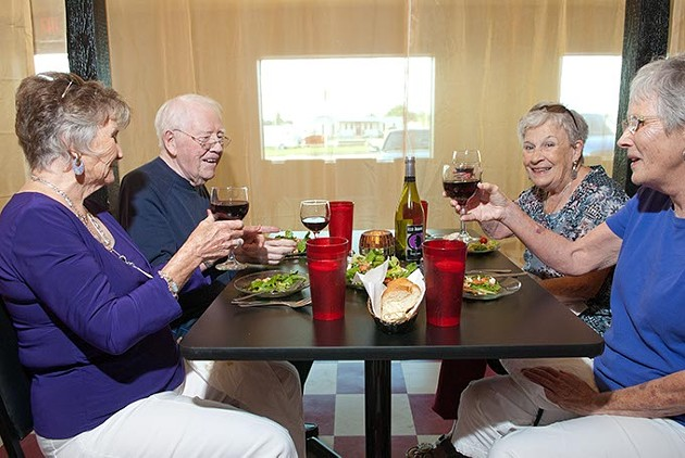 From left, Helen and Jim Fisher from Yukon, Betty Cluck and Marsha Fisher, at The Vine.  mh