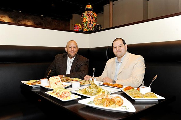 Brothers Arturo and Marco Chavez pose for a photo at the new 1492 New World Latin Cuisine location in Oklahoma City, Friday, Nov. 20, 2015. - GARETT FISBECK