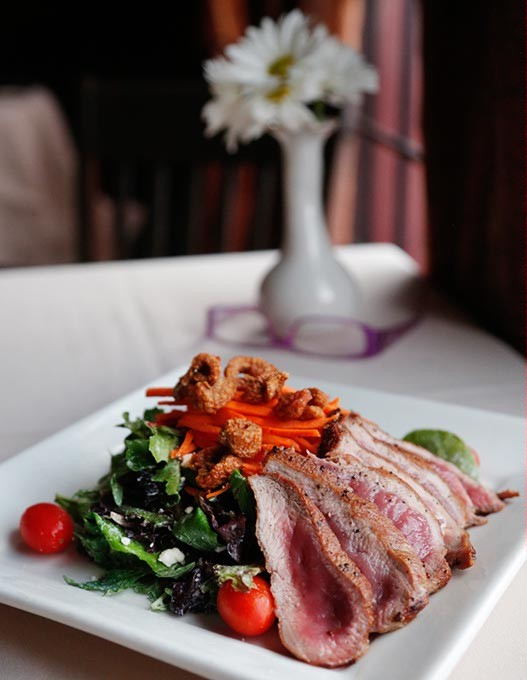 Maple Leaf Duck Salad at Paseo Grill in Oklahoma City, Thursday, May 14, 2015. - GARETT FISBECK
