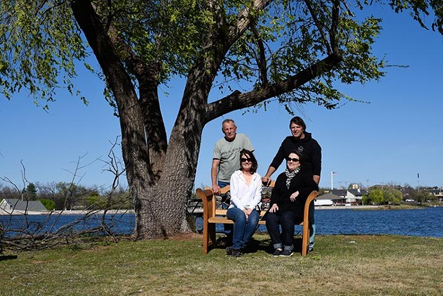 Mike and Marilyn Gushwa, and Steve and Kim Iraggi, who are involved in the planning of the Ski Island sock burning ceremony, pose for a photo, Tuesday, March 15, 2016. - GARETT FISBECK