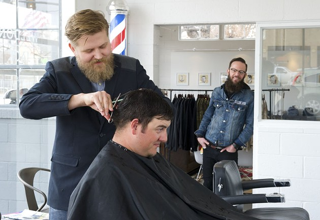 Travis Whitmire has his hair cut by Jake Phelps as Jerrod Smith looks on at Weldon Jack. Photo/Shannon Cornman